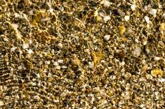 Mármores na água do mar de cristal fotografia de stock