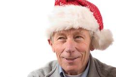 Más viejo hombre sonriente con el sombrero de santa imagenes de archivo