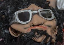 Máscara con el pelo negro y los vidrios para el día de fiesta de Purim Fotos de archivo libres de regalías