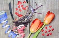 Máscara con los tulipanes y el confeti Imagen de archivo