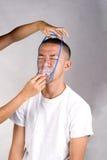 Máscara de oxigénio e paciente Fotografia de Stock Royalty Free