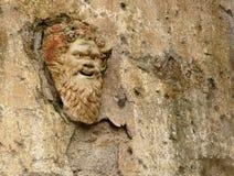 Máscara de piedra antigua en Herculaneum, Italia Foto de archivo libre de regalías