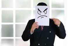 Máscara de Wearing Angry Face del hombre de negocios Fotos de archivo