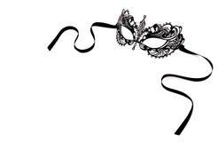 Máscara delicada preta do laço em um fundo branco Máscara preta do carnaval do metal fotografia de stock royalty free