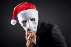 Máscara do homem de negócios asiático novo e chapéu brancos vestindo de Santa Foto de Stock