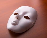 Máscara do teatro na tabela Fotografia de Stock Royalty Free