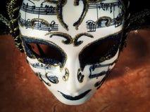 Máscara e música imagem de stock