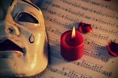 Máscara e vela de Pierrot Fotografia de Stock Royalty Free