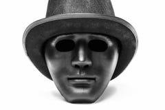 Máscara humana negra en sombrero Fotos de archivo libres de regalías