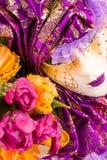 Máscara púrpura veneciana Fotos de archivo libres de regalías