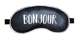 Máscara preta do sono com ` do ` do ` de Bonjour do ` da palavra escrita olá! na língua francesa, cumprimento comum ilustração royalty free