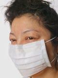 Máscara protectora desgastando fêmea Fotos de Stock Royalty Free