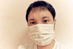 Máscara protetora vestindo Foto de Stock