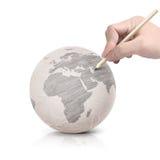 Máscara que tira o mapa de Ásia na bola de papel Imagem de Stock