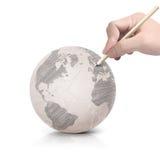 Máscara que tira o mapa de América na bola de papel Foto de Stock