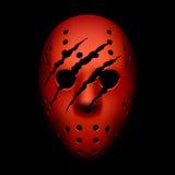 Máscara roja del hockey con los rastros de garras Foto de archivo