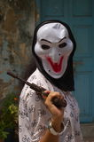 Máscara y arma Imagen de archivo libre de regalías