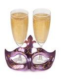 Máscara y champán Fotos de archivo