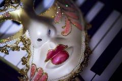 Máscara y música fotos de archivo libres de regalías