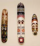 Máscaras africanas em uma parede Fotografia de Stock