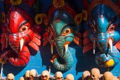 Máscaras de madeira da lembrança de Nepal de deuses hindu Fotos de Stock Royalty Free