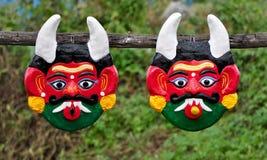 Máscaras del demonio imagenes de archivo