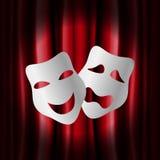 Máscaras del teatro con la cortina roja Foto de archivo