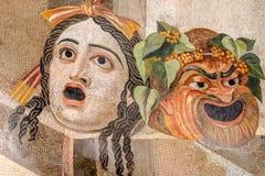Máscaras del teatro en el museo de Roma National Imagen de archivo libre de regalías