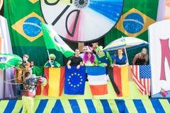 Máscaras do carnaval com bandeiras Fotografia de Stock