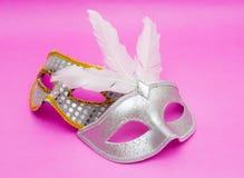 Máscaras do carnaval no fundo cor-de-rosa Fotos de Stock