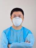 Máscaras e vestuário de proteção Fotos de Stock