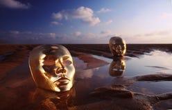 Máscaras en el agua Foto de archivo libre de regalías