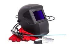 Máscaras protectoras y guantes del ` s del soldador Fotografía de archivo libre de regalías