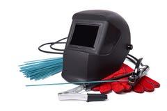 Máscaras protectoras y los guantes del soldador Imagenes de archivo