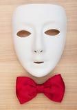 Máscaras y pajaritas en la madera Imágenes de archivo libres de regalías