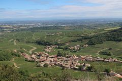 Mâcon wine-growing region. Photography taken from the Rock of Solutré and showing a small village located in a wine-growing region. The Rock of Solutré is a royalty free stock photography