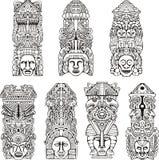 Mâts totémiques aztèques Images stock