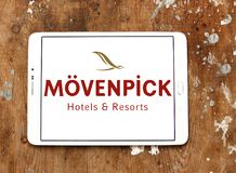Mövenpick hotell- och semesterortlogo Arkivfoto