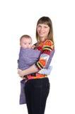 Mãe com o bebê no estilingue imagem de stock royalty free