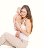 Mãe e bebê novos de sorriso felizes no branco Imagens de Stock