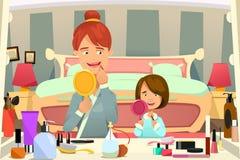 Mãe e filha que aplicam a composição Fotografia de Stock