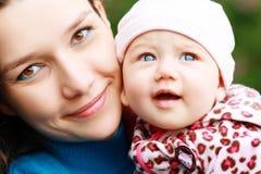 Mãe nova com bebê Fotos de Stock Royalty Free