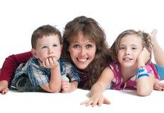 Mãe nova com duas crianças Foto de Stock Royalty Free