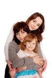 Mãe que abraça com duas filhas fotografia de stock royalty free