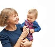 Mãe que agrada seu bebê imagem de stock royalty free