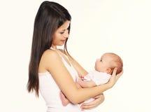 A mãe que guarda sobre entrega seu infante imagem de stock royalty free