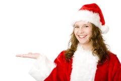 Mão aberta de sorriso feliz da terra arrendada da mulher de Papai Noel Foto de Stock