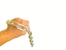 Mão acorrentada com a corrente do ferro, isolada no fundo branco Fotografia de Stock