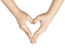 A mão adolescente fêmea faz a forma do coração com mãos Imagens de Stock Royalty Free