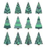 A mão afoga as árvores de Natal ajustadas Imagens de Stock Royalty Free
